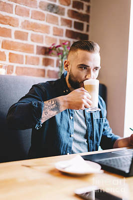 Photograph - Man Drinking Coffee, Looking At His Laptop. by Michal Bednarek