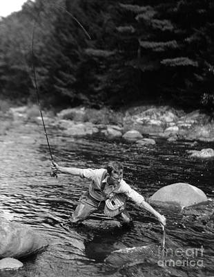 Man Fishing In Stream Art Print by H. Armstrong Roberts/ClassicStock