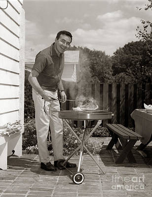 Man Grilling In Backyard, C.1960s Art Print by H. Armstrong Roberts/ClassicStock