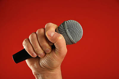 Aromatherapy Oils Royalty Free Images - Man hand with microphone over red background Royalty-Free Image by Anton Eine
