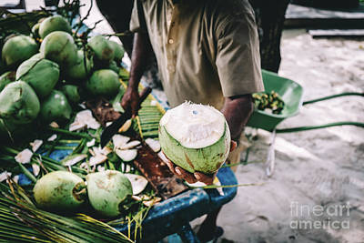 Photograph - Man Handing In A Green Coconut. Traditional Local Agriculture. by Michal Bednarek