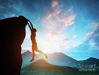 Photograph - Man Hanging On The Edge Of Mountain At Sunset by Michal Bednarek