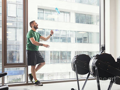 Photograph - Man In A Gym Throwing A Bottle Up In The Air. by Michal Bednarek