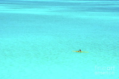 Photograph - Man In An Outrigger Canoe In A Blue Lagoon by IPics Photography