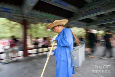 Photograph - Man In Blue by Hans Janssen