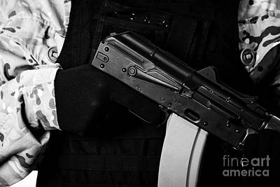 Man In Combat Fatigues And Bullet Proof Jacket Holding Aks-47u Close Quarter Combat Kalashnikov Rifl Print by Joe Fox