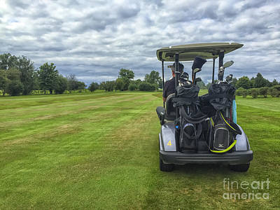 Photograph - Man In Golf Buggy On Course by Patricia Hofmeester