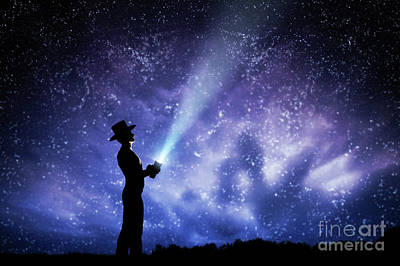 Glow Photograph - Man In Hat Throwing Light Beam Up The Night Sky Full Of Stars. To Explore, Dream, Magic. by Michal Bednarek