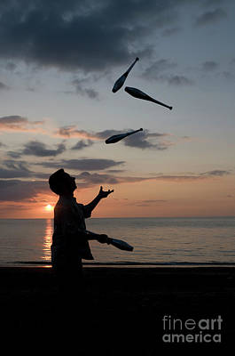 Man Juggling With Four Clubs At Sunset Art Print by Keith Morris