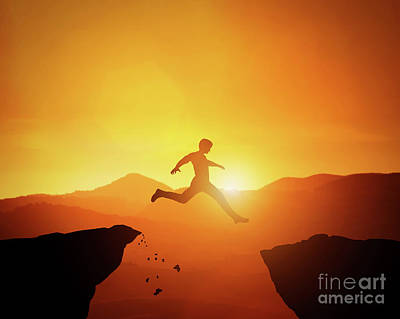 Photograph - Man Jumping From One Rock To Another. Sunset Mountains Scenery by Michal Bednarek