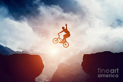 Rider Photograph - Man Jumping On Bmx Bike Over Precipice In Mountains At Sunset by Michal Bednarek