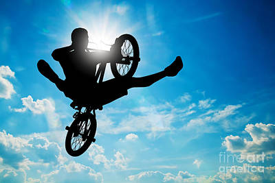 Dynamic Photograph - Man Jumping On Bmx Bike Performing A Trick Against Sunny Sky by Michal Bednarek