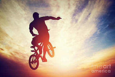 Perform Photograph - Man Jumping On Bmx Bike Performing A Trick Against Sunset Sky by Michal Bednarek