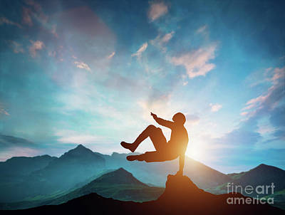 Photograph - Man Jumping Over Rocks In Parkour Action In Mountains. by Michal Bednarek