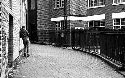 Photograph - Man Leaning Against Brick Wall by Jacek Wojnarowski