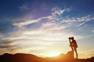 Photograph - Man Looking Through Binoculars At Sunset. by Michal Bednarek