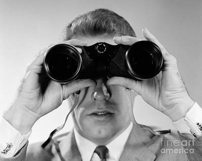 Man Looking Through Binoculars, C.1960s Art Print by H. Armstrong Roberts/ClassicStock
