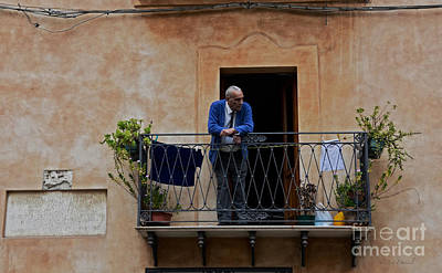 Photograph - Man On Balcony by Jan Daniels