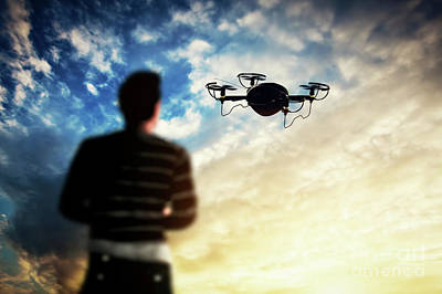 Control Photograph - Man Operating A Drone At Sunset. by Michal Bednarek