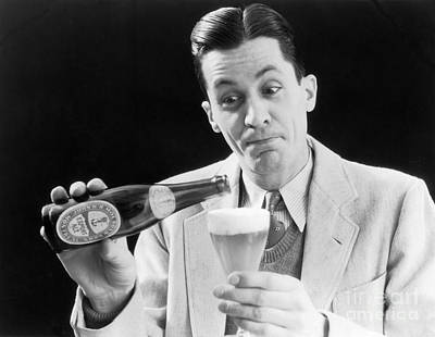 Man Pouring A Glass Of Beer, C.1930s Art Print by H. Armstrong Roberts/ClassicStock