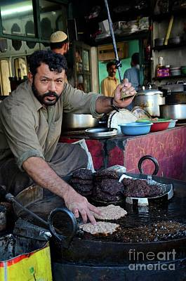 Photograph - Man Prepares Pakistani Chapli Kebab Meat Dish On Skillet Gilgit Pakistan by Imran Ahmed