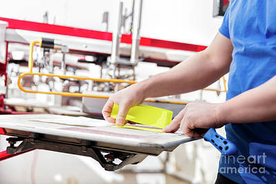 Electronic Photograph - Man Preparing Fabric For Screen Printing. by Michal Bednarek