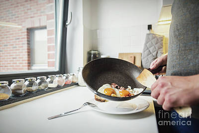 Indoor Photograph - Man Putting Fried Eggs On The Plate by Michal Bednarek