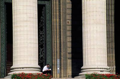 Man Reading A Book Beside The Columns Of La Madeleine Church In Paris Art Print