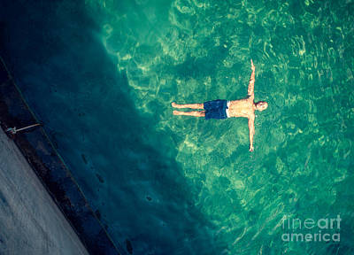 Photograph - Man Relaxing In The Pool by Anna Om
