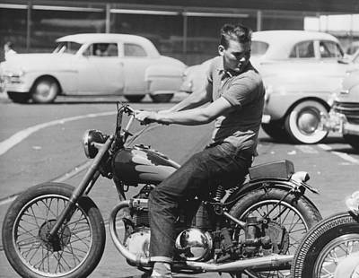 Photograph - Man Riding A Motorcycle by Underwood Archives