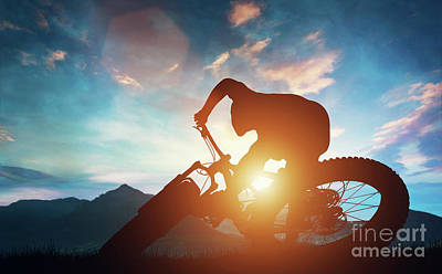 Photograph - Man Riding His Bike In Mountains During Sunset. by Michal Bednarek