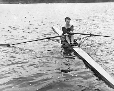 Rowing Photograph - Man Rowing A Scull by Underwood Archives