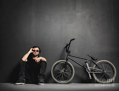 Photograph - Man Sitting Next To His Bmx Bike, Adjusting His Sunglasses. by Michal Bednarek