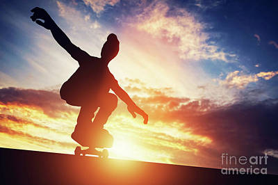 Photograph - Man Skateboarding At Sunset. by Michal Bednarek