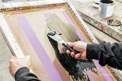 Screen Photograph - Man Squeegeeing Silkscreen In A Workshop. Serigraphy by Michal Bednarek