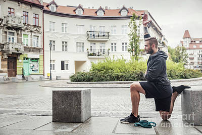 Photograph - Man Stretching His Legs In The City by Michal Bednarek
