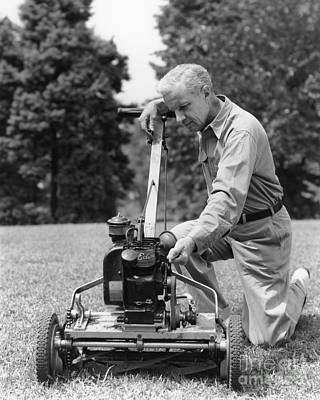 Man Tinkering With Lawnmower, C.1940s Art Print by H. Armstrong Roberts/ClassicStock
