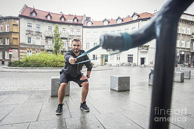 Photograph - Man Toning His Body In An Outdoor City Training. by Michal Bednarek