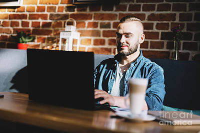 Photograph - Man Typing On A Laptop In A Cafe. by Michal Bednarek