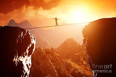 Concentration Photograph - Man Walking And Balancing On Rope Over Precipice In Mountains At Sunset by Michal Bednarek