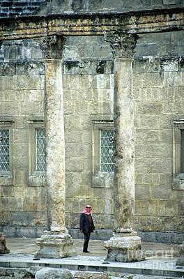 Man Walking Between Columns At The Roman Theatre Art Print by Sami Sarkis