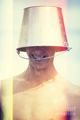 Beer Royalty-Free and Rights-Managed Images - Man wearing water bucket on head in summer heat by Jorgo Photography - Wall Art Gallery