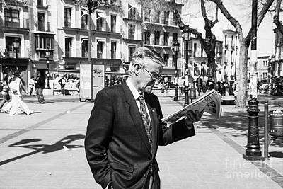 Photograph - Man With Paper by Rick Bragan