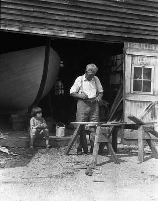 Old Grandfather Time Photograph - Man Woodworking While Boy Looks On by H. Armstrong Roberts/ClassicStock