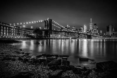 Manhattan Skyline And Brooklyn Bridge Nightly Stroll Along The River Bank  Art Print
