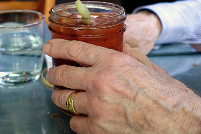 Bloody Mary Photograph - Mans Hand Holding Bloody Mary  by Beth Wolff