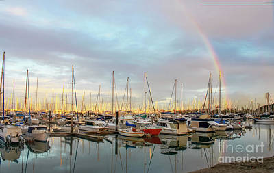 Photograph - Marina At The Golden Hour With Sunshine Highlighting The Masts Of The Sailboats And A Rainbow In The by Susan Vineyard