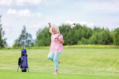 Photograph - Mature Woman Jumping With Success On A Golf Course. by Michal Bednarek