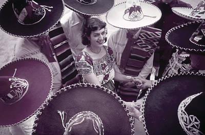 Mexican American Photograph - Men In Sombreros Surround A Woman by B. Anthony Stewart