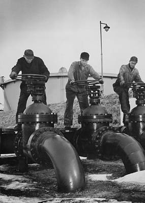 Occupational Portraits Photograph - Men Turn The Wheels Of Large Valves by Everett